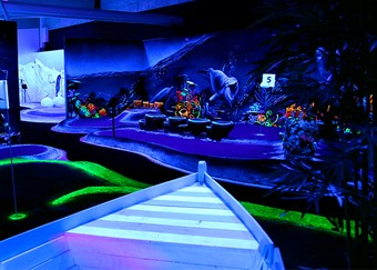 Black light golf with boat
